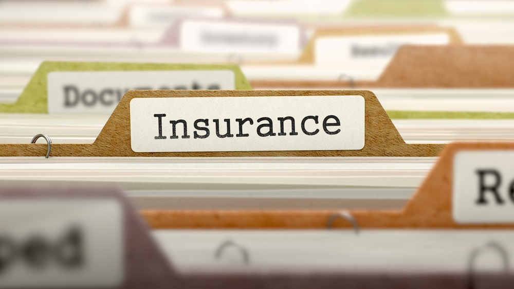 Insurance - Folder Register Name in Directory. Colored, Blurred Image. Closeup View..jpeg