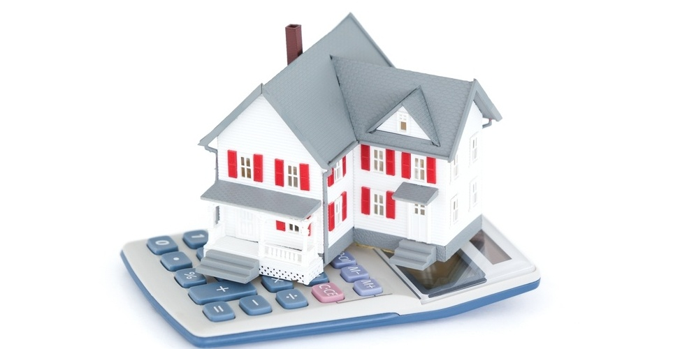 Miniature house with a calculator against a white background-495384-edited.jpeg
