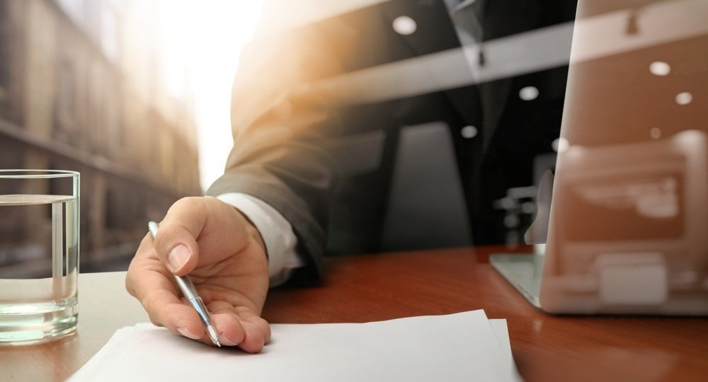 double exposure of businessman or salesman handing over a contract on wooden desk-436589-edited.jpeg